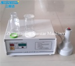 Portable hand operated electromagnetic induction sealing machine